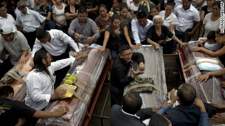 Relatives mourn the loss of their family members, victims of the 7.8-magnitude earthquake, during a funeral service in Portoviejo, Ecuador, Monday, April 18, 2016.
