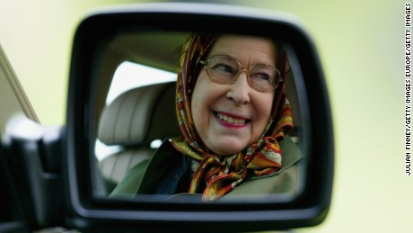 WINDSOR, ENGLAND - MAY 14:  Queen Elizabeth II is seen reflected in the wing mirror of her Land Rover as she follows The Duke of Edinburgh as he competes in the Driving Grand Prix Competition B - The Marathon event during the Royal Windsor Horse Show at Home Park, Windsor Castle on May 14, 2005 in Windsor, England.  (Photo by Julian Finney/Getty Images)