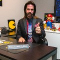 Billy Mitchell sits in his office at Metro Wrapz, in Hollywood, Florida, where he is developing custom arcade game covers.