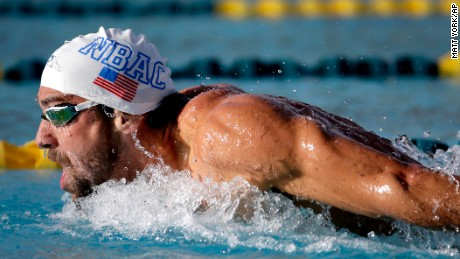 Michael Phelps competes in the 200-meter butterfly final at the Arena Pro Swim Series swim meet, Friday, April 15, 2016, in Mesa, Ariz. (AP Photo/Matt York)