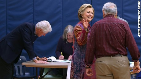 Democratic presidential candidate former Secretary of State Hillary Clinton and her husband former U.S. president Bill Clinton greet poll workers before voting at Douglas Grafflin Elementary School on April 19, 2016 in Chappaqua, New York.