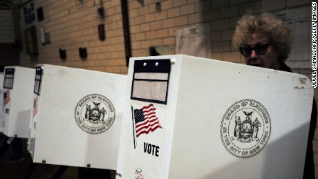A woman casts her vote at a polling station in New York on April 19, 2016.