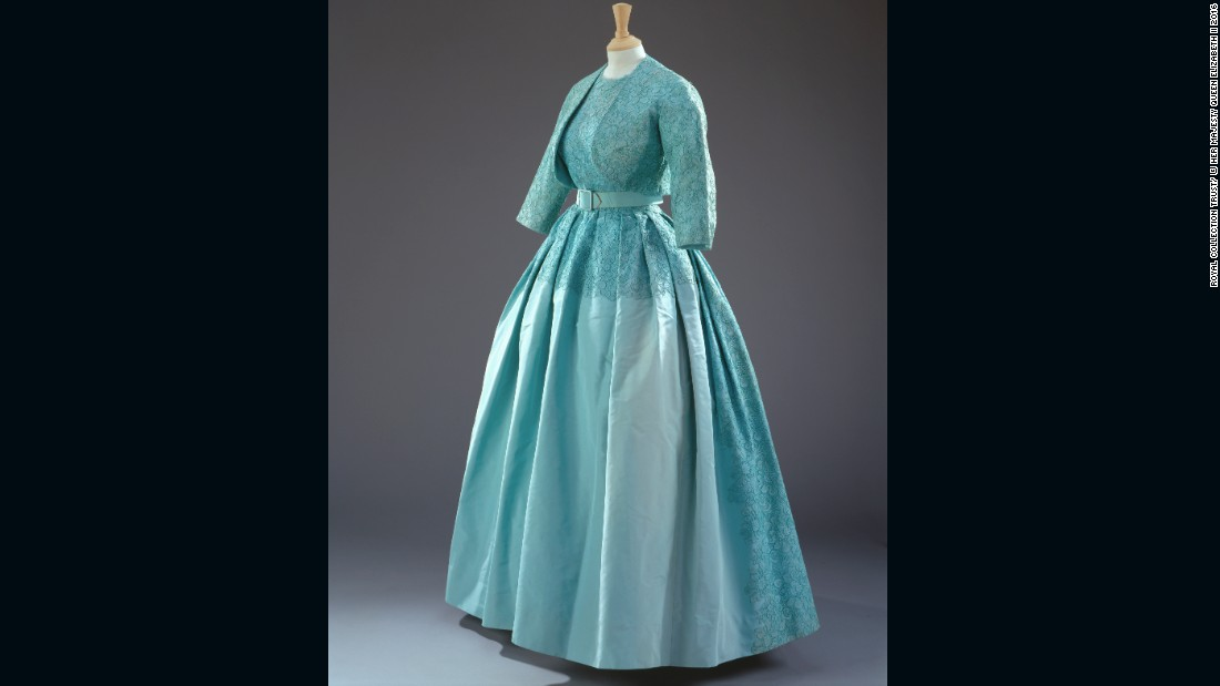Turquoise dress with a matching bolero jacket of silk taffeta, guipure lace and silk tulle by Norman Hartnell, worn to Princess Margaret's wedding.