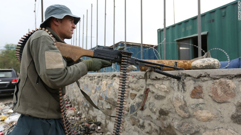 An Afghan security force responds to a Taliban-claimed suicide attack in Kabul, Afghanistan, Tuesday, April 19, 2016. Taliban insurgents have stepped up their attacks against the security forces since announcing the start of their spring offensive last week. (AP Photo/Rahmat Gul)