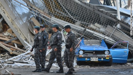 Rescuers search for victims in Manta, Ecuador on April 19, two days after the 7.8-magnitude quake that struck the region.