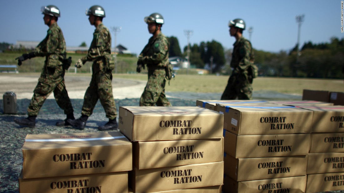 Japan Self-Defense Forces prepare relief supplies delivered by a U.S Marine Corp Osprey on April 19 in Minamiaso.