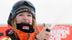 A picture taken on April 2, 2016 shows World champion Switzerland's Estelle Balet celebrating with champagn after she won the women's snowboard event at the Bec des Rosses during the Verbier Xtreme Freeride World Tour final above the Swiss Alps resort of Verbier.  An avalanche in the Swiss Alps on April 19, 2016 swept away two-time world extreme snowboard champion Estelle Balet to her death, police said. The 21-year-old Swiss woman, who had won her second title on the Freeride World Tour only two weeks ago, was making a film when she was killed, Swiss police said in a statement. Balet was speeding down a slope on her snowboard when the avalanche started and carried her away, police added. / AFP / FABRICE COFFRINI        (Photo credit should read FABRICE COFFRINI/AFP/Getty Images)