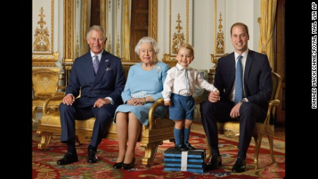 In this image released by the Royal Mail on Wednesday April 20, 2016, Britain's Prince George stands on foam blocks during a photo shoot for the Royal Mail in the summer of 2015 in the White Drawing Room at Buckingham Palace in London for a stamp sheet to mark the 90th birthday of Britain's Queen Elizabeth II.  The image features four generations of the Royal family, from left, Prince Charles, Queen Elizabeth II, Prince George and Prince William, the Duke of Cambridge. (Ranald Mackechnie/Royal Mail via AP) MANDATORY CREDIT