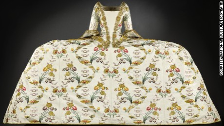 Court mantua, c1750s The mantua was worn for court occasions and was designed to be a luxurious garment, often decorated with opulent embroidery incorporating gold or silver thread, to display status and wealth. This example, brocaded in gold and trimmed with gilt lace, is thought to have belonged to the Countess of Haddington. It is particularly interesting to the contemporary eye not only for its extravagance -- the fabric alone would cost the equivalent of around £5,000 today -- but for its sheer enormity.