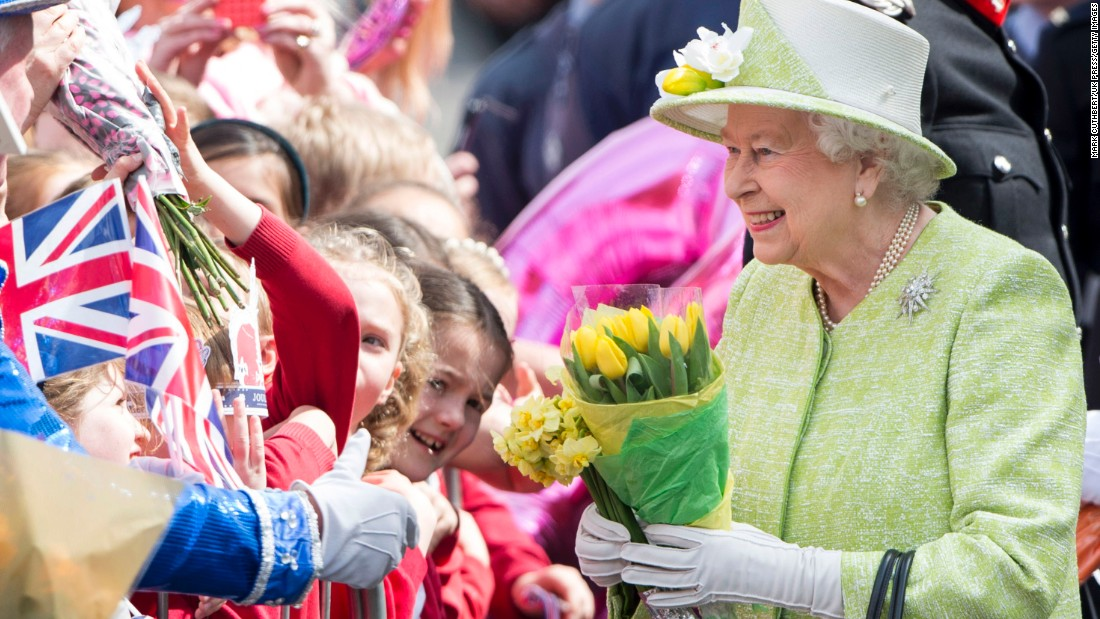 Queen Elizabeth II acknowledges the crowd as she celebrates her 90th birthday in Windsor, England, on April 21.