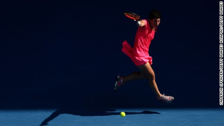 MELBOURNE, AUSTRALIA - JANUARY 20:  Caria Suarez Navarro of Spain plays a backhand in her second round match against Maria Sakkari of Greece during day three of the 2016 Australian Open at Melbourne Park on January 20, 2016 in Melbourne, Australia.  (Photo by Cameron Spencer/Getty Images)