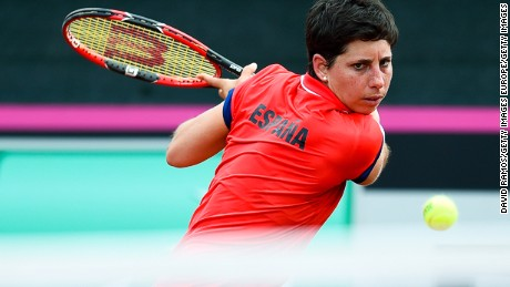 LLEIDA, SPAIN - APRIL 16:  Carla Suarez Navarro of Spain plays a backhand against Roberta Vinci of Italy during day one of the Fed Cup World Group Play-off Round match between Spain and Italy on April 16, 2016 in Lleida, Spain.  (Photo by David Ramos/Getty Images)