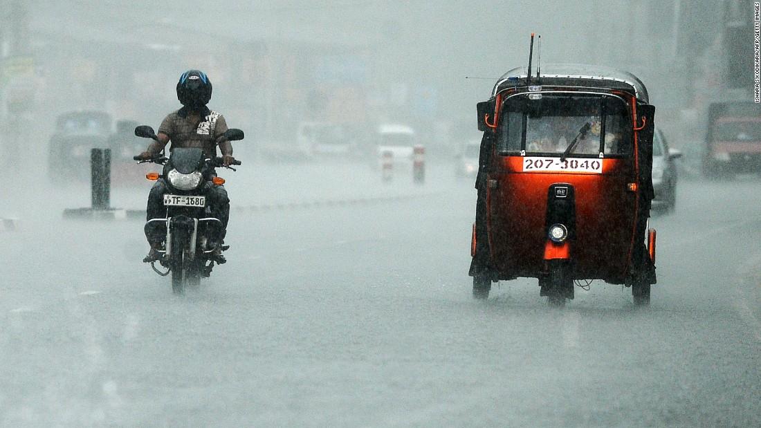 Commuters drive through heavy rain in Colombo, Sri Lanka, on Tuesday, April 19.