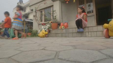 Nepal earthquake anniversary girl leg Kathmandu ns orig_00031127