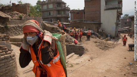 In Sankhu, a small village devastated by the earthquake 100 local workers hired by the IOM clear rocks and dirt almost a year after the earthquake.