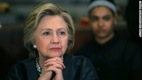 Hillary Clinton looks on during a roundtable discussion with community members at Orangeside on Temple on April 23, 2016 in New Haven, Connecticut.