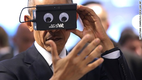 Obama tests virtual reality goggles at the Hannover Messe on April 25.