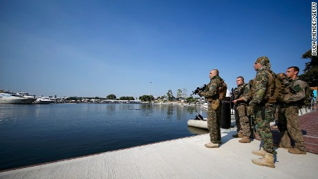 Keeping watch - Members of Brazil's military police at the marina which will be home to Olympic sailing events. Water pollution at this venue and security concerns are just two of the issues Rio organizers face.