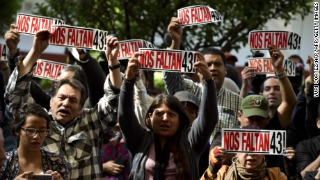 Parents and other relatives of the 43 missing students from the Ayotzinapa's teachers school attend the reading of the final report from the Interdisciplinary Group of Independent Experts (GIEI) in Mexico City on April, 24, 2016. / AFP / YURI CORTEZ        (Photo credit should read YURI CORTEZ/AFP/Getty Images)