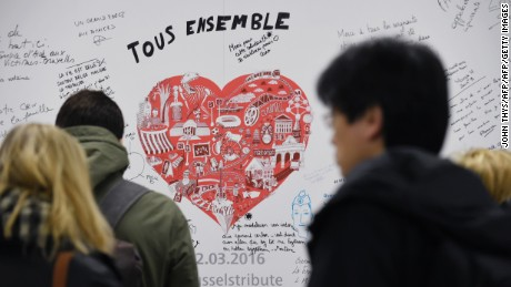 People read messages on a commemorative wall at the Maelbeek - Maalbeek metro station on its re-opening day on April 25, 2016 in Brussels, after being closed since the 22 March attacks in the Belgian capital. Maelbeek - Maalbeek metro station was hit by one of the three Islamic State suicide bombers who struck Brussels airport and metro on March 22, killing 32 people and injuring hundreds. / AFP PHOTO / JOHN THYSJOHN THYS/AFP/Getty Images