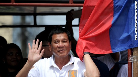 In this photo taken on March 2, 2016, shows Davao City Mayor and Presidential Candidate Rodrigo Duterte waves to his supporters during his campaign sortie in Lingayen, Pangasinan, north of Manila. Rodrigo Duterte curses the pope's mother and jokes about his own infidelities, but many voters in the Philippines want to elect him president so he can begin an unprecedented war on crime. / AFP / NOEL CELIS / TO GO WITH AFP STORY: Philippines-vote-rights-crime-Duterte, FOCUS by Karl Malakunas        (Photo credit should read NOEL CELIS/AFP/Getty Images)