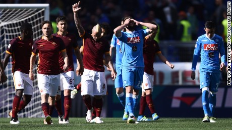 Roma's midfielder Radja Nainggolan celebrates after his goal ended Napoli's slim title hopes.