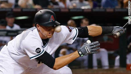 Arizona Diamondbacks' Nick Ahmed fouls a pitch off his face during the sixth inning of a baseball game against the Pittsburgh Pirates on Friday, April 22, 2016, in Phoenix. (AP Photo/Ross D. Franklin)