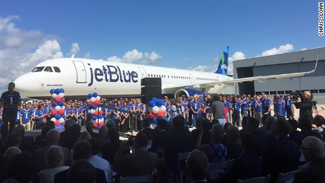 Airbus employees and guests gather around BluesMobile on Tuesday, April 25, to see the first aircraft built in Airbus Brookley Aeroplex Final Assembly Line in Mobile, Alabama . This is the first Airbus plane built in the US.