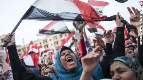 Egyptians celebrate in front of the presidential palace of Ethadya in the capital Cairo on June 3, 2014 after ex-army chief Abdel Fattah al-Sisi won 96.9 percent of votes in Egypt's presidential election.