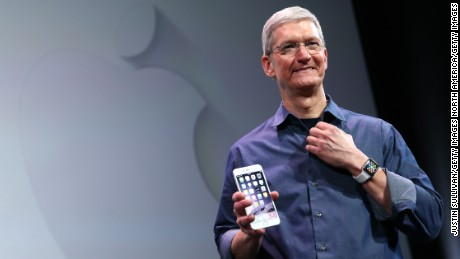 Apple CEO Tim Cook shows off the new iPhone 6 and the Apple Watch during an Apple special event at the Flint Center for the Performing Arts on September 9, 2014 in Cupertino, California. Apple is expected to unveil the new iPhone 6 and wearble tech.  (Photo by Justin Sullivan/Getty Images)