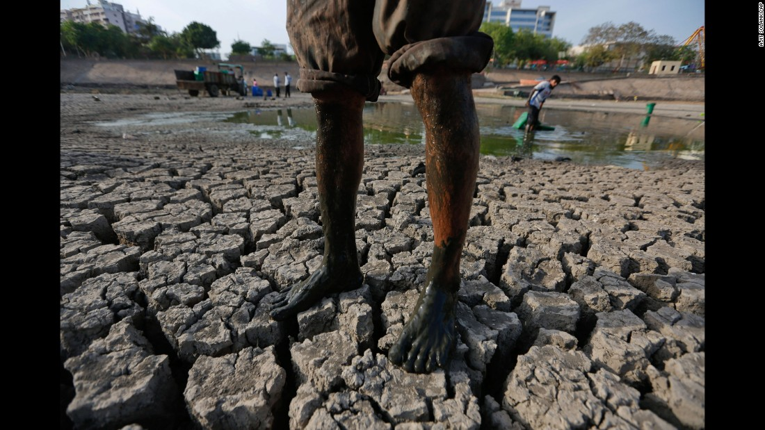 A man stands on the parched bed of Vastrapur Lake in Ahmadabad, India, on Sunday, April 24.