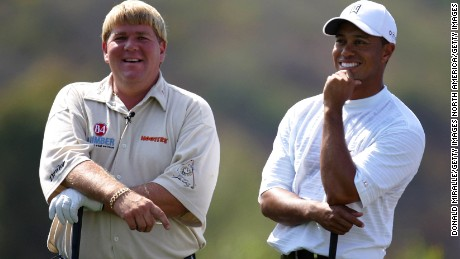 RANCHO SANTE FE, CA - JULY 25:  John Daly and teammate Tiger Woods joke on the 1st tee during the Battle at the Bridges on July 25, 2005 at The Bridges at Rancho Sante Fe in Rancho Sante Fe, California.  (Photo by Donald Miralle/Getty Images)