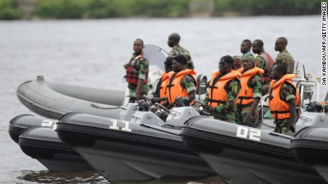 Soldiers of the Ivorian navy commandos stand on speedboats newly purchased by Ivorian navy from France at Abidjan military base, on June 23, 2014, before the arrival of the newly purchased RPB 33 patrol boat. This is the first of three patrol boats purchased by Ivorian navy from France as part of an Ivorian Defence program to develop its navy as it confronts a growing threat from pirates in the Gulf of Guinea. AFP PHOTO/ SIA KAMBOU        (Photo credit should read SIA KAMBOU/AFP/Getty Images)