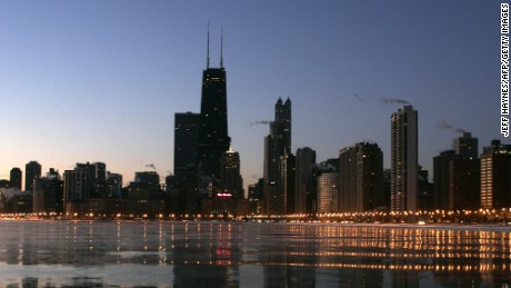 The Chicago skyline glows along Lake Michigan 08 February 2007 in Chicago, Illinois. Record cold temperatures have been recorded in the mid-west this week.   (Photo credit should read JEFF HAYNES/AFP/Getty Images)