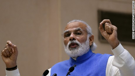 Indian Prime Minister Narendra Modi gestures as he speaks during the launch the National Agriculture Market, an e-market platform at Vigyan Bhawan in New Delhi on April 14, 2016.