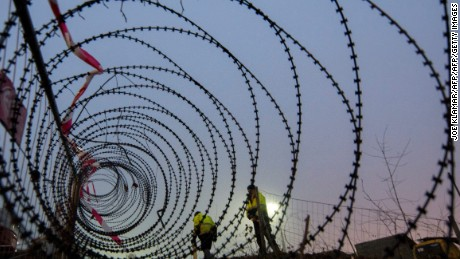 Workers complete a 3.7 kilometer stretch of fence at the Spielfeld border crossing between Austria and Slovenia in December.