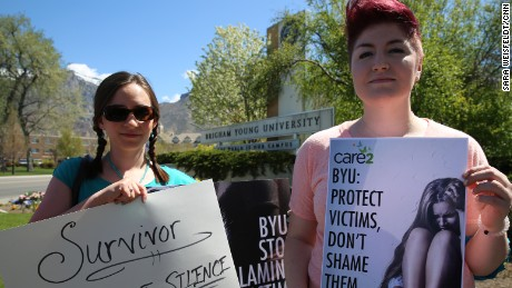 Sarah Belt, left, and Nyrie Hadnot are not students but attended a rally at Brigham Young University to support sexual assault survivors and fight for immunity for rape victims.