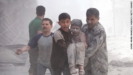 ALEPPO, SYRIA - APRIL 28:  People carry an injured boy after Russian forces staged air-strike over Aleppo's opposition controlled Sukkeri region, Syria on April 28, 2016. (Photo by Omar Arab/Anadolu Agency/Getty Images)