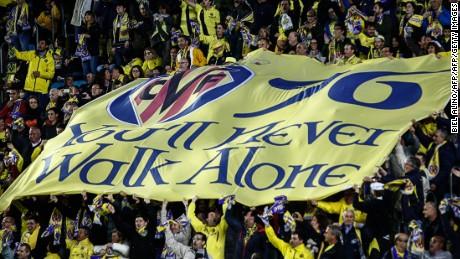 Villarreal supporters unfold a banner during the UEFA Europa League semifinal first leg football match Villarreal CF vs Liverpool FC at El Madrigal stadium in Vila-real on April 28, 2016. / AFP / BIEL ALINO        (Photo credit should read BIEL ALINO/AFP/Getty Images)