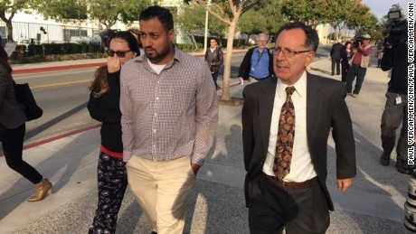 Photo: Raheel Farook, his wife Tatiana, freed after pleading not guilty to marriage Fraud charges. 