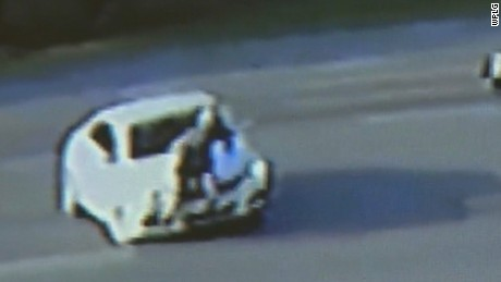 NS Slug: FL: MAN CLINGS TO CAR IN ROAD RAGE INCIDENT  Synopsis: An odd road rage incident is caught on camera  Keywords: FLORIDA MAN ROAD RAGE CLINGS CAR