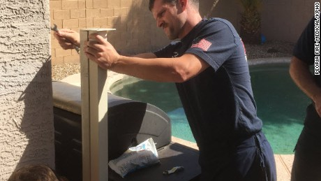 After near-drowning fire crews stay to fix gate