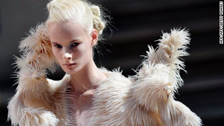 A model presents a creation by Iris Van Herpen during the Haute Couture Fall-Winter 2013/2014 collection shows, on July 1, 2013 in Paris.  AFP PHOTO/MIGUEL MEDINA        (Photo credit should read MIGUEL MEDINA/AFP/Getty Images)