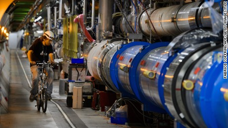 A worker rides on his bicycle in the CERN's Large Hadron Collider (LHC) tunnel during maintenance works on July 19, 2013 in Meyrin, near Geneva. Tests at the world's biggest collider have provided the most exhaustive confirmation to date of the Standard Model, a four-decade-old conceptual framework for fundamental particles, CERN said.   AFP PHOTO / FABRICE COFFRINI        (Photo credit should read FABRICE COFFRINI/AFP/Getty Images)