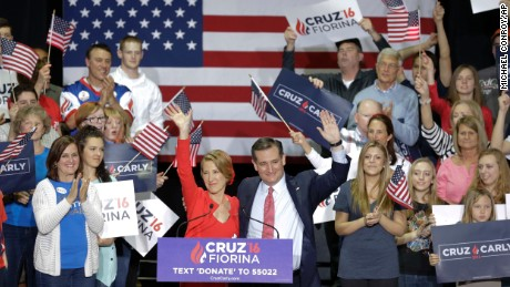 Republican presidential candidate Sen. Ted Cruz, R-Texas, joined by former Hewlett-Packard CEO Carly Fiorina waves during a rally in Indianapolis, Wednesday, April 27, 2016, when Cruz announced he has chosen Fiorina to serve as his running mate. (AP Photo/Michael Conroy)