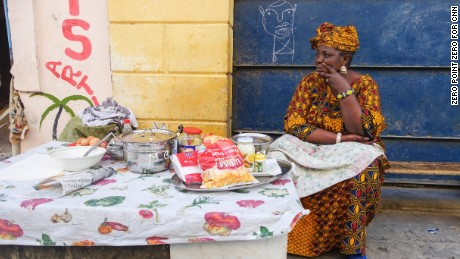 PUAB Ep 407 - Senegal Production stills  A breakfast vendor waits for customers in Saint-Louis, Senegal