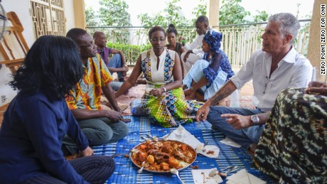 PUAB Ep 407 - Senegal Production stills  Tony joins Chef Pierre Thiam at his aunt's house with family and friends for homecooked, Thieboudienne