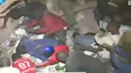 Search for survivors after deadly Kenya building collapse...