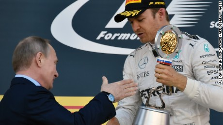 Mercedes AMG Petronas F1 Team's German driver Nico Rosberg is congratulated by Russian President Vladimir Putin after winning the Formula One Russian Grand Prix at the Sochi Autodrom circuit on May 1, 2016.  / AFP / ALEXANDER NEMENOV        (Photo credit should read ALEXANDER NEMENOV/AFP/Getty Images)