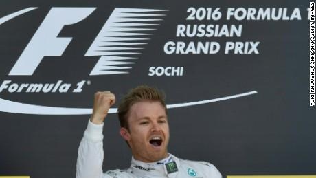Mercedes AMG Petronas F1 Team's German driver Nico Rosberg celebrates on the podium after winning the Formula One Russian Grand Prix at the Sochi Autodrom circuit on May 1, 2016.  / AFP / YURI KADOBNOV        (Photo credit should read YURI KADOBNOV/AFP/Getty Images)